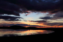 Sunset on a small lake in Iceland Stock Images