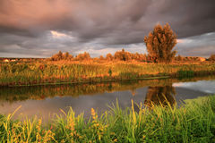 Sunset on the small river stock photography