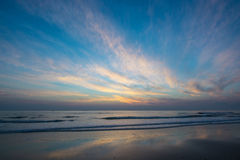 Sunset and smooth of the sea wave Stock Photography