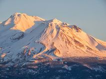 Sunset on snow capped mountain royalty free stock images