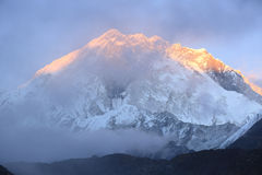 Sunset on snow capped mountain on the way to everest base camp Royalty Free Stock Photo