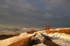 Sunset on the snow-covered countryside Royalty Free Stock Images