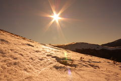 Sunset and snow in the Pyrenees. Sun and snowy mountain in Pyrenees,Aude,Languedoc region of France Stock Image