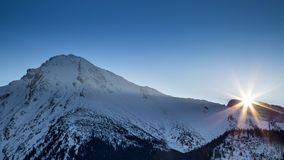 Sunset in a snowy alpine landscape. High Tatras National Park, Slovakia, Europe Royalty Free Stock Images