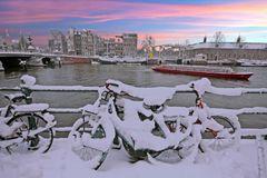 Sunset in snowy Amsterdam in the Netherlands at the Amstel. In winter Royalty Free Stock Image