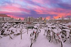 Sunset in snowy Amsterdam in the Netherlands at the Amstel. In winter Stock Images