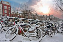 Sunset in snowy Amsterdam in the Netherlands Royalty Free Stock Images