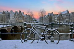 Sunset in snowy Amsterdam in the Netherlands Royalty Free Stock Photos