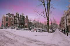 Sunset in snowy Amsterdam in the Netherlands Stock Image