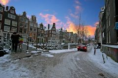 Sunset in snowy Amsterdam in the Netherlands Royalty Free Stock Photo