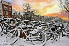 Sunset in snowy Amsterdam in the Netherlands Stock Photos