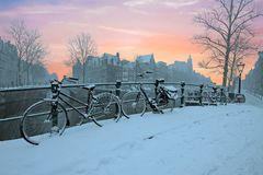 Sunset in snowy Amsterdam in the Netherlands Stock Images