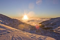 Sunset in the snowy mountains of the Carpathians.  Stock Photos