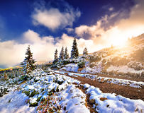 Sunset in the snowy mountains Royalty Free Stock Photography
