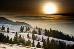 Sunset on snowy mountains Stock Images