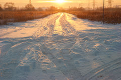 Sunset snowy road Stock Photography