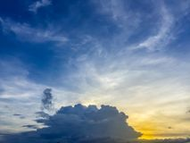 Sunset with soft blue sky late afternoon background. Early morn. Ing blue sky and bright clouds with good weather. Sunny day afternoon in early winter create a stock image