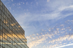 Sunset soft cloudy sky and reflex in modern building Royalty Free Stock Photos