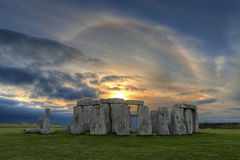 Sunset Solar Halo over Stonehenge. Image of Stonehenge  at sunset with beautiful solar sunset halo in vibrant colors. A halo is an optical phenomenon that Royalty Free Stock Image