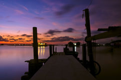 Sunset on Songkhla lake, Thailand. Silhouette bridge and house at sunset time on the lake Stock Photos