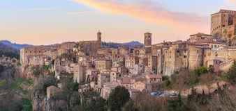 Sunset in Sorano. Sorano is a town and comune in the province of Grosseto, southern Tuscany. It as an ancient medieval hill town hanging from a tuff stone Stock Photo
