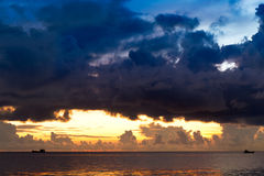 Sunset at South China Sea,  Vietnam. Sunset at South China Sea with threatening sky and ships, Phu Quoc, Vietnam Stock Image
