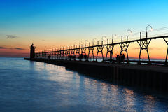 Sunset in South Haven Pier with Lighthouse Royalty Free Stock Photo