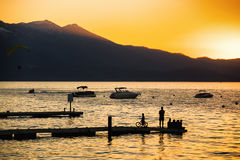 Sunset South Lake Tahoe. Silhouette of people at sunset Lake Tahoe California, USA Royalty Free Stock Image