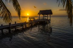 Sunset at South Water Caye - Small tropical island at Barrier Reef with paradise beach - known for diving, snorkeling and relaxing. Vacations - Caribbean Sea stock images
