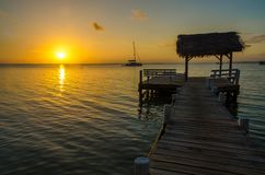 Sunset at South Water Caye - Small tropical island at Barrier Reef with paradise beach - known for diving, snorkeling and relaxing. Vacations - Caribbean Sea stock image