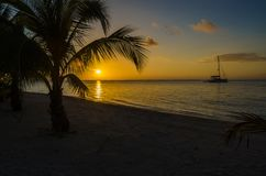Sunset at South Water Caye - Small tropical island at Barrier Reef with paradise beach - known for diving, snorkeling and relaxing. Vacations - Caribbean Sea stock photography