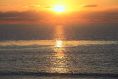 Sunset in southern California. A shining sun at sunset over the Pacific ocean Royalty Free Stock Photos