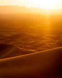 Sunset and speeding car from sand dunes in Erg Chebbi, Morocco Stock Photo