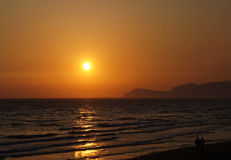 Sunset sperlonga. Sunset san felice circeo with silhouettes of couples in love on the beach Stock Photos
