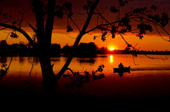 Sunset in the spring lake. Sunset in the spring time lake and boat Royalty Free Stock Photo