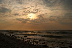 sunset on the spring May sea beach royalty free stock photo