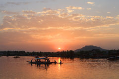 The sunset in Srinagar City (India). Srinagar is the summer capital of the Indian state of Jammu and Kashmir. It lies in the Kashmir Valley, on the banks of the royalty free stock photography