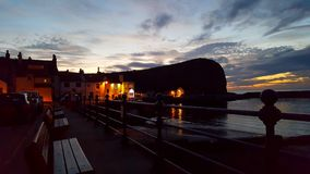 Sunset at staithes harbour stock images