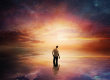 Sunset with stars. A man looks up at a beautiful sunset with shining stars stock photo