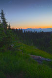 Sunset, Mountains, Meadows and Stars. Golden Sunset, majestic mountains, green meadows and stars at dusk in the Olympic National Park, Washington state, USA Stock Photo