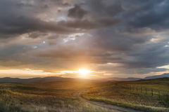 Sunset in the steppe, a beautiful evening sky with clouds, plato Ukok, no one around, Altai, Siberia, Russia. Stock Image