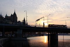 Sunset in Stockholm, Sweden. Travel in Stockholm, Sweden. across the bridge. beautiful harbor/ scene. sightseeing in Europe. sunset. there are many ships and Royalty Free Stock Photos