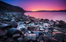Sunset on the stone coast Royalty Free Stock Photo