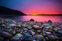 Sunset on the stone coast Royalty Free Stock Images