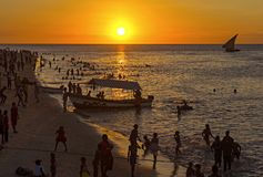 Sunset of Stone Town in Zanzibar, Tanzania. A traditional dhow n stock image
