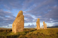 Sunset stones. Ring of Brodgar in dramatic evening light and cloudscape royalty free stock photography