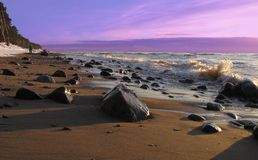 Sunset stones. Someone has covered the sunset by stones. Evening has coming on Baltic shore close Klaipeda, Lithuania. Gorgeous panorama of sunset and sea Stock Image