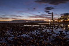 Sunset from the stones. Sunset on the beach of Maspalomas Gran Canaria Royalty Free Stock Images