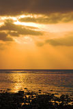 Sunset after the storm. Beautiful sunset on the beach after a storm Stock Photography