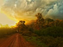 Sunset Storm Clouds. Setting sun with storm clouds rolling in stock photography